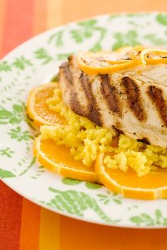 1 teaspoon Paula Deen Hot Sauce or to taste  1 tablespoon grated fresh ginger  6 tablespoon freshly squeezed orange juice  1 tablespoon grated orange zest  6 tablespoon olive oil, plus additional for brushing  6   (6-ounce) tilapia fillets  1 teaspoon salt  freshly ground black pepper  mango coconut rice