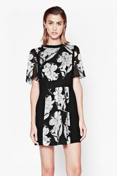 "<ul> <li> Fit and flare floral print dress</li> <li> Short floral print semi-sheer sleeves</li> <li> Centre back zip fastening with hook and eye clasp</li> <li> Fitted waistband</li> <li> Flared, pleated detail at skirt</li> <li> Contrasting block colour panel round neckline</li> <li> UK size 10 length is 81.7cm</li> </ul>  <strong>Our model is 5ft 10.5"" and is wearing a UK size 10.</strong>"