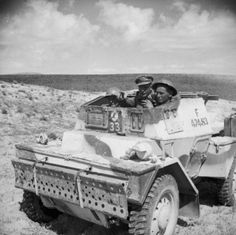 Royal Engineers in a Daimler scout car on their way to blow up an abandoned enemy tank, to prevent it being recovered and repaired, 14 March 1943.