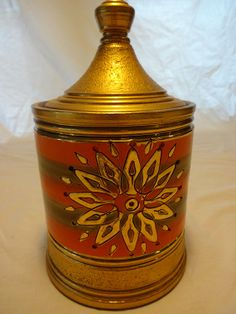 """Stunning vintage Rosenthal Netter lidded jar, attributed to Aldo Londi. One small ding in the top rim (see pic) on the rear, otherwise in mint condition. Great orange and golds.  Measures 9.5"""" tall x 5.5"""" wide."""