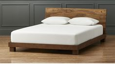 "<span class=""copyHeader"">dream teak.</span> Eco platform sleeps sustainably sound with headboard of teak planks reclaimed from homes no longer in use in India. Handplaned smooth, each plank patterns unique interest with its variegated tone, active grain, natural knots, splits and markings. Solid sustainable mango wood base is precision crafted with exposed peg joinery on low-profile block feet. Mattresses available, sold separately.<br /><br /><NEWTAG/><ul><li>Headboard is solid teak…"