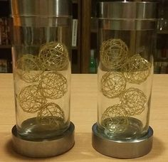 Candlesticks decorated with golden balls.