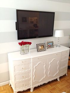 """This is my version of an """"entertainment center"""". Love it! Chic cabinet under a flat screen."""