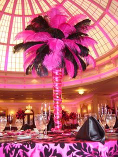 Hot pink and black Ostrich feathers at reception... I'd tone it down a touch but LOVE it :)