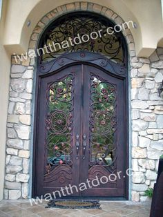 double iron entry doors with transom-love the scroll pattern. Could make me forget & Masterpiece Doors u0026 Shutters. Single entry door with sidelights ... pezcame.com
