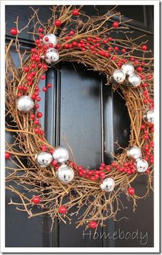 Twig wreath + fake berries (cut with wire cutter, glued with hot glue) + silver ornaments
