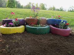 Anybody, got old tires setting around the farm or garage, this is a real cute idea to make use of them. in the corner of a fence would be cute, too!!
