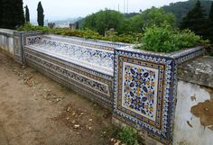A tile clad bench in Tomar overlooking the castle walls and town below