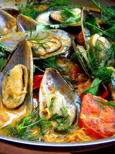 Mussels with a light touch of Thai curry, herbs and tomatoes broth.