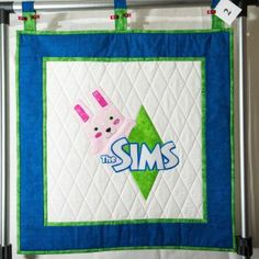 These The Sims Quilts are once in a lifetime opportunity to get true collectors items! A Quilt made by @SimGuruAmy, Development Manager of The Sims 4 and signed by many familiar names from The Sims team.