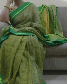 Pure linen light green saree with dark green border