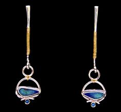 Cynthia Downs earrings  |  Australian boulder opals, London blue topaz, 22k gold and sterling silver.