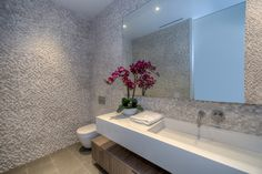 Stone tiles walls provide modern texture   Bathroom at Carla Ridge in Beverly Hills By Boswell Construction #buildboswell