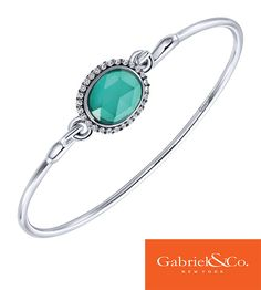 Silver Multi Color Stones Bangle by Gabriel & Co. This multi colored stone makes this bracelet stand out and shine especially in the spring and summer! Add this to your arm candy to make a little pop!