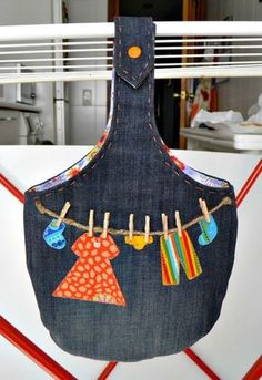 this IDEA rocks! - clothespin bag (hooks over the line) with jute clothesline, appliques, and wee pins added!