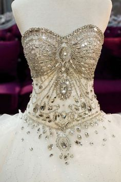 the perfect bedazzled jeweled big poofy wedding dress for all the cinderella princess brides out there.
