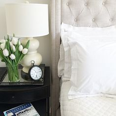White tulips, white lamp, white bedding — this bedroom is all about the first signs of spring. (via @savorhome on Instagram)
