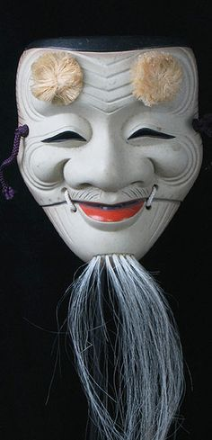 Okina mask  Japan  8 inches, painted ceramic  Okina (or Hakushikijo) is the name of this very popular Noh character. He makes for an especially stunning piece of art the Japanese like to hang in their homes... as do many others around the world