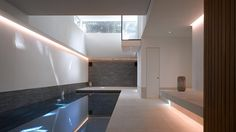 """This west London house has been overhauled by British architects Theis + Khan to include a """"cave-like"""" pool in the basement and a twisting white staircase Cinema Architecture, White Staircase, Basement Pool, Mix Use Building, Gate House, Indoor Swimming Pools, London House, House On A Hill, House Extensions"""
