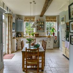 Country kitchen with Shaker units and farmhouse table