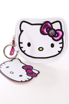 This adorable Hello Kitty coin bag is a must have! Featuring Hello Kitty face, candies print, faux leather, o ring, and end with a top zipper closure.