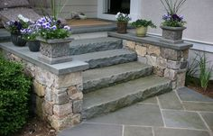 alternative front steps - solid Bluestone Slabs. [a bit more contemporary than stone risers and a bluestone tread]