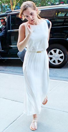 Celebrity Street Style Picture Description Emma Watson is wearing a white maxi dress with a skinny white belt, shoulder bag and gold sandals. - #StreetStyle https://looks.tn/celebrity/street-style/celebrity-street-style-emma-watson-is-wearing-a-white-maxi-dress-with-a-skinny-white-belt-shoulder-bag/