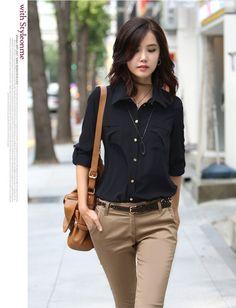 I like the combination of black top, khaki pants, brown accessories, feminine jewelry.