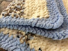 Crochet blanket -my son wanted a very cosy blanket. Used Bernat Baby Blanket and Bernat Blanket yarn.