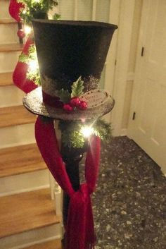 Snowman hat heading up the stairs, on the staircase post