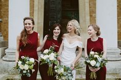 Bridesmaids wear dark red jumpsuits | Photography by http://www.davidjenkinsphotography.com/