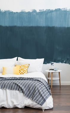 Hitting the snooze button in this bedroom would be too easy. Calming blues help to paint the ultimate serene bedroom space, combined with brush stroke textures for a hand finished look. Pair with pops of yellow to contrast the blue for a playful touch!