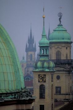 Towers of Clementinum and the church of Our Lady in front of Týn at Old Town Prague, Czechia