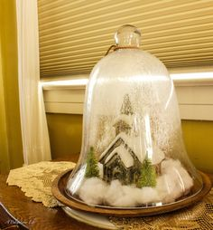 take a large bell jar, a Church Christmas decor, some batting and some bottlebrush tree add spray snow and you have a lovely Snow Globe for Christmas