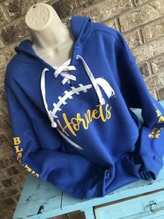Football Hoodie with lace up front and football laces with name Cold Game, Band Mom, Football Love, Kangaroo Pouch, Sports Mom, Up Front, Team Names, Mom Shirts, Hoodies
