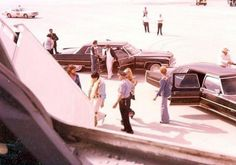 Elvis - Boarding the Lisa Marie with Linda Thompson in Atlanta, GA on June 6, 1976 -  also pictured are Sonny West, Dr. Nick, Al Strada, Charlie Hodge and Red West