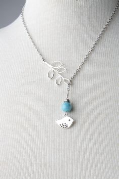 Silver bird and branch lariat necklace with blue