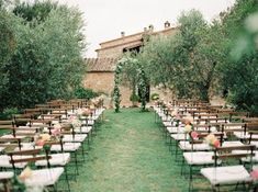 The Lazy Olive is a stunning farmhouse venue in the hills of Siena Italy. Perfect for romantic wedding ceremonies with rustic wood chairs and blush wedding flowers. Photographer: Peaches & Mint