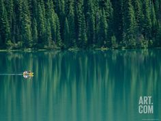 Canoeing on Still Water of Yoho National Parks Emerald Lake Photographic Print by Michael Melford at Art.com