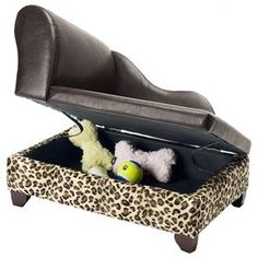Lounge-style storage pet bed with leopard-print detail.     Product: Pet bed  Construction Material: Wood and foam  Color: Leopard    Features: Top lifts to reveal storage area  Accommodates pets up to 10 lbs  Furniture grade construction    Dimensions: 14 H x 21 W x 14 D    Cleaning and Care: Spot clean with a damp cloth