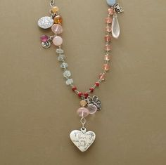 """Dripping with turquoise, sunstone, moonstone, quartz, tourmaline, citrine and amethyst gemstones along with whitehearts and sterling silver charms representing good luck, growth, courage, integrity, Jes MaHarry's necklace culminates with """"your beautiful love is in my soul."""" Exclusive. Handmade in USA."""