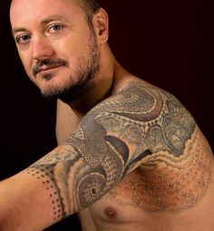 Geometric dragon Tüskevár tattoo art