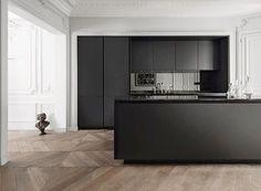 High contrast kitchen! Oak chevron patterned floors + black kitchen! | Designed by Siematic Kitchens @siematicusa! #siematickitchen #interiordesign