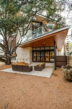 Rich wood ceilings, floors and accent walls throughout give this modern University Park, Texas, home a warm ambiance. The open floor plan is complemented by folding-glass doors that can be opened for true indoor-outdoor living. >> http://www.hgtv.com/design/ultimate-house-hunt/2017-ultimate-house-hunt/modern-masterpieces/modern-masterpieces-open-concept-home-natural-elements