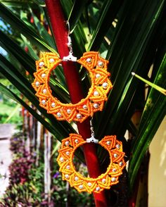 A personal favorite from my Etsy shop https://www.etsy.com/listing/511664408/macrame-earrings-orange-flower-with