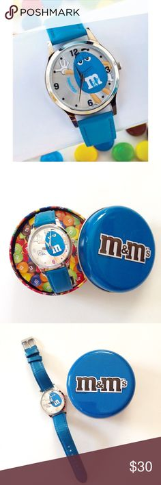 New M & M's Candy Collector's Watch Blue  Take your own sweet time with this one-of-a-kind M & M Blue Character Watch. Genuine leather strap and a clear rotating disc with lovable Blue on the face. Vibrant and fun timepiece for collectors and chocolate  lovers  Includes tin can case. New battery and works perfectly! #collectible #mms #mmschocolate #bluemm #timepiece #collectiblewatch #lovewatches #timepieces #girlboss   #watchlife  #watchcollecting #watchcollectinglifestyle #blue  #follow❤…