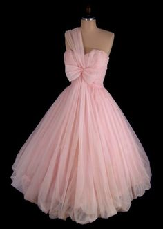 This stunning baby pink nylon chiffon party or prom dress features a strapless boned bodice, strap, nipped waist & elegant full skirt w/ a bubble hem. A gorgeous party dress, perfect for your holiday events! Retro Mode, Vintage Mode, Vintage Pink, Vintage Party, Vintage Outfits, Vintage Dresses, Vintage Clothing, Vintage Shoes, Clothing Ideas