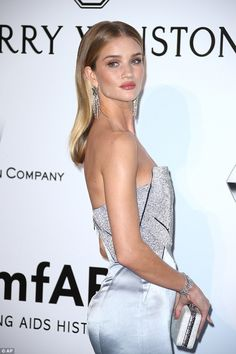 Rosie Huntington-Whiteley: Futuristic glamour in a strapless pale blue Galvan gown with a metallic bodice, shoes (Jimmy Choo), matching box clutch (Bulgari), jewels (Swarovski), Makeup (Florrie White), stylist (Cher Coulter) | amfAR's 23rd Cinema Against AIDS Gala at Hotel du Cap-Eden-Roc on May 19, 2016