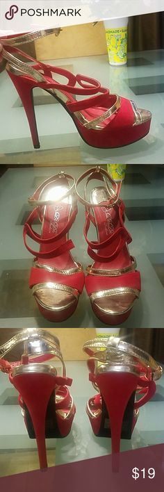 Strappy Red Heels Size 9 NWOT Strappy Red and Gold heels size 9. These are new and sexy stilettos. I love them but I have too many shoes. Size 9. Sparkly enough for New Years Eve party or sexy Christmas / holiday party.  Save 10% on ALL bundles! I ship the same day if ordered before 3pm! Shoes Heels