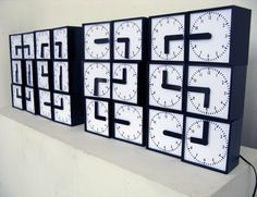 Digital Clock Made of 24 Analogue Clocks (4 pics + video) : Very creative and neat to watch.